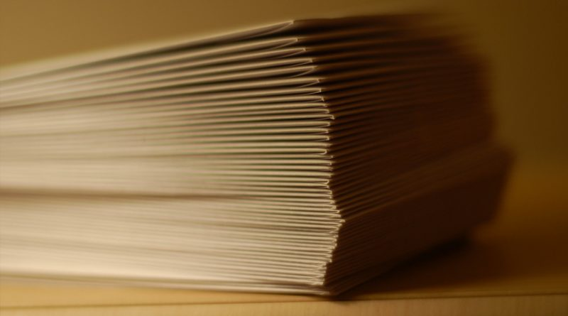 a stack of business envelopes